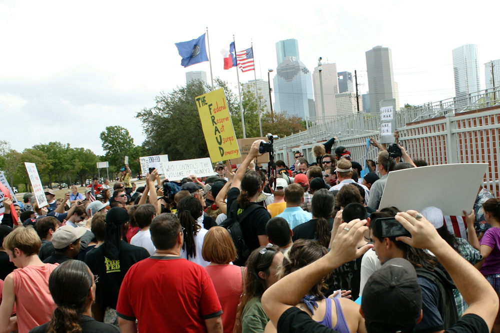 occupy houston the fed wall street federal reserve protest demonstration assembly sign democrats republicans dallas austin san antonio ron paul economy debt