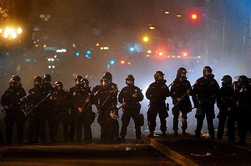 Occupy Oakland: Militarized Police use teargas to drive back occupiers ...