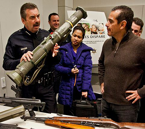 LAPD Chief Charlie Beck and Mayor Antonio Villaraigosa marvel at a badass paperweight
