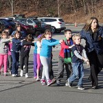 School-children are escorted by officers in Newtown, CT