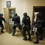 SWAT in school: Men is riot gear wearing ski masks and wielding assault rifles are your friends