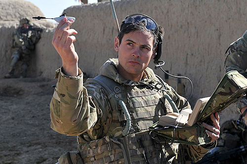 British Army Sgt. Scott Weaver of the Queens Royal Lancers prepares to dispatch a Black Hornet mini-drone by Norwegian manufacturer Prox Dynamics.