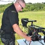 Arlington Police Officer Steve Dollar plays with yet another toy from Homeland Security.