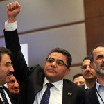 Ghassan Hitto (with arm raised) beside Syria's main opposition National Council chief Ahmed Moaz al-Khatib (right).