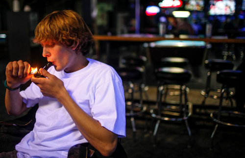 Russell Diercks smokes marijuana inside of Frankie Sports Bar and Grill in Olympia, Washington on December 9, 2012