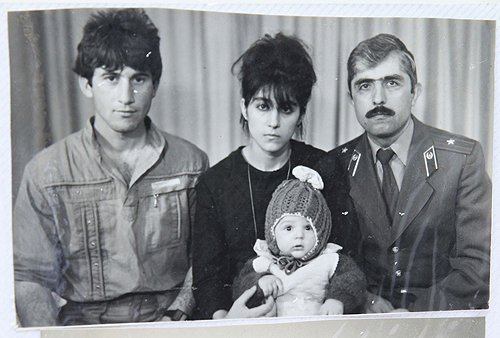 Baby Tamerlan Tsarnaev with (L-R) father Anzor, mother Zubeidat, and uncle Muhamad Suleimanov